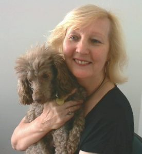 Velma Violet Harris holding Coco the toy Poodle